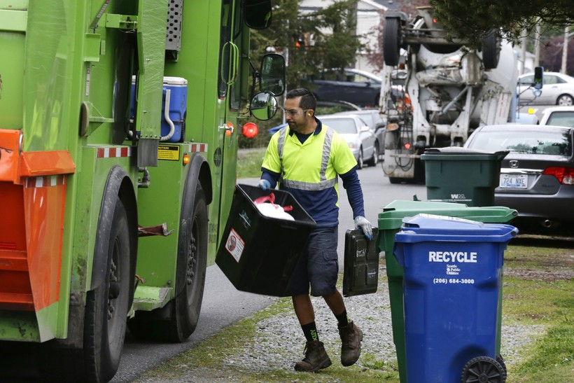 Man collecting trash and recycling