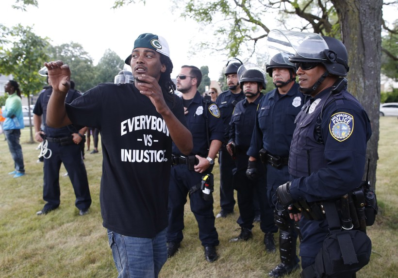 Milwaukee resident speaks with police officers during a demonstration in August 2016