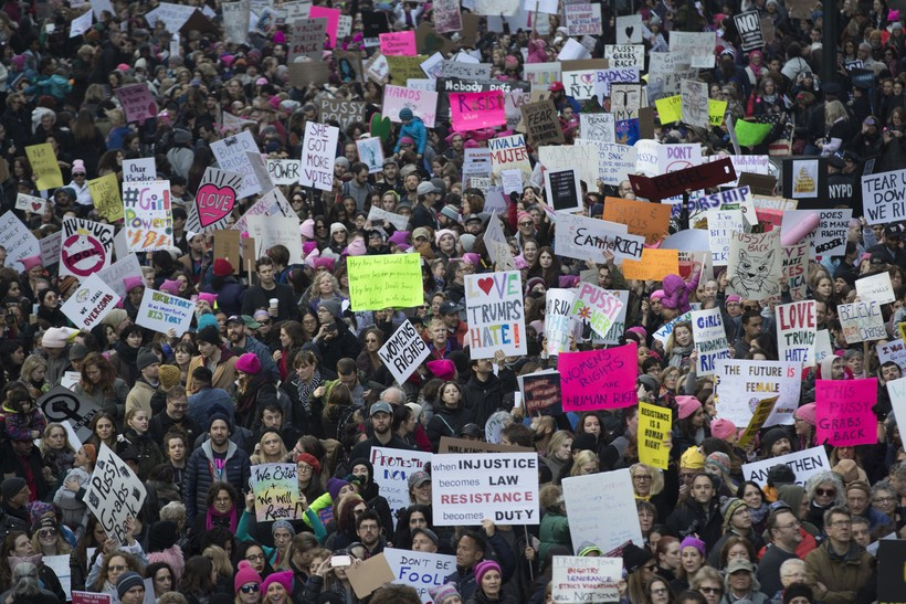 Demonstrators march across 42nd Street during a women's march,