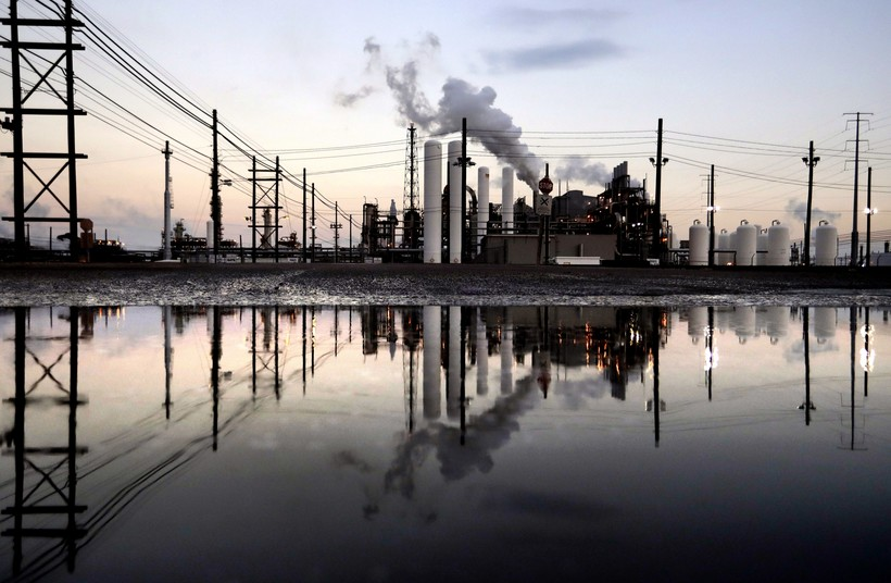 Oil refinery mirrored in water in Texas