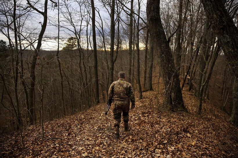 Hunter walking in the woods