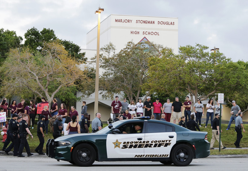 Police car in front of Marjory Stoneman Douglas High School