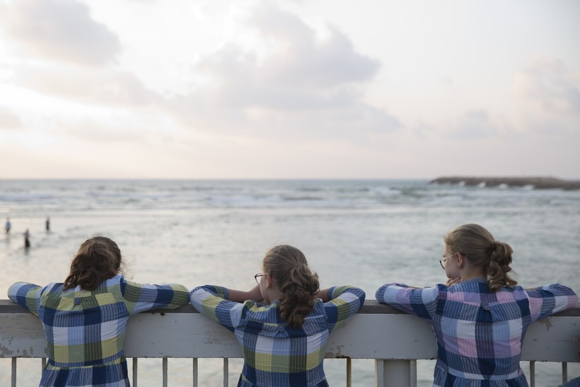 girls looking at beach