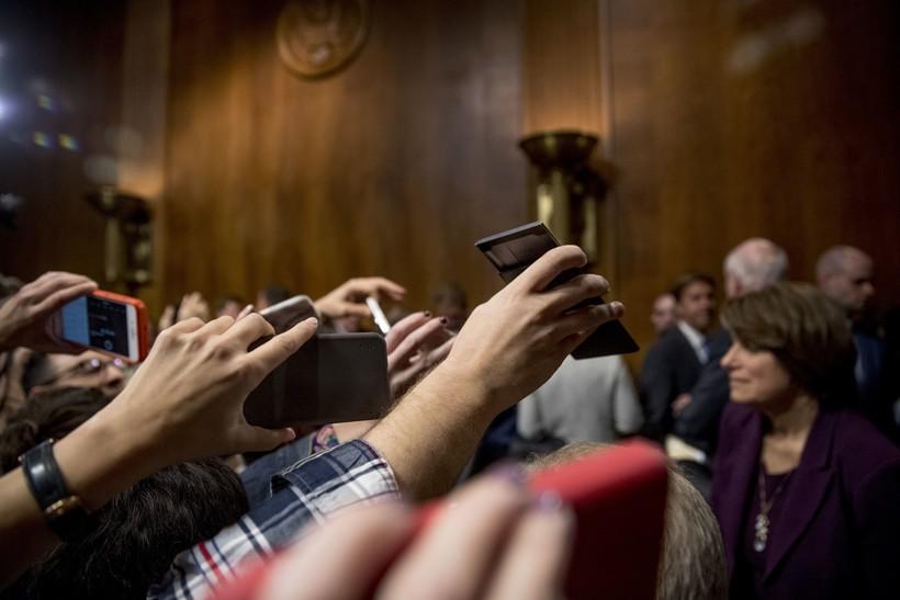 Reporters crowd Senators at the Senate Judiciary Committee hearing