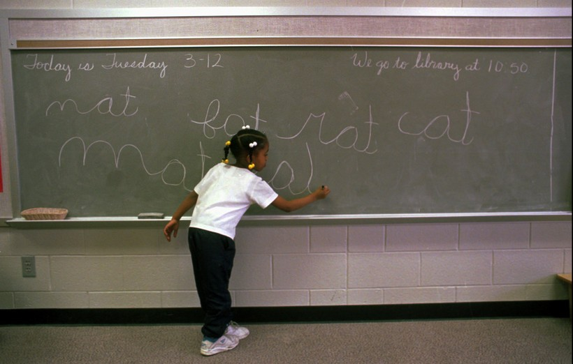 Child writing on a chalkboard