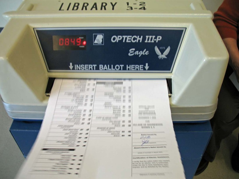 Ballot being fed into voting machine