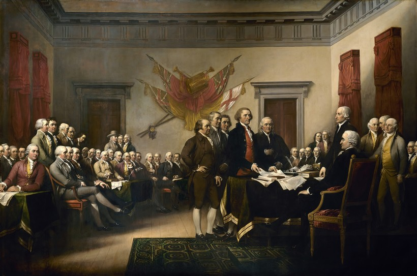 Painting of the founding fathers with the declaration of independence