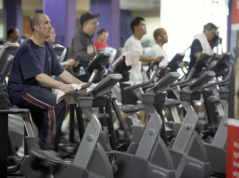 People on exercise bikes and treadmills