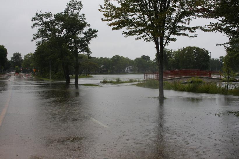 Flood water seeps acrossEast Johnson Streetin Madison