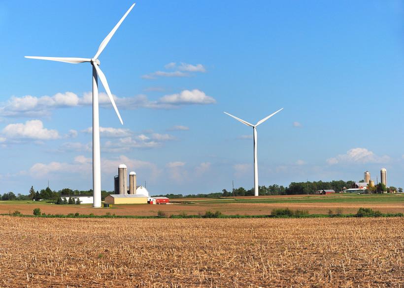 Wind turbines near farms