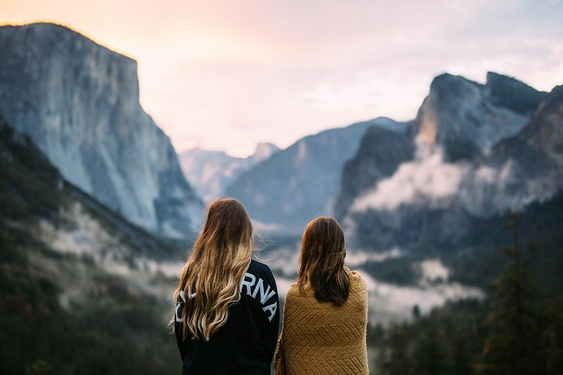 two women looking at mountain scenery