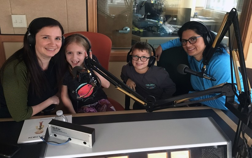Naudia Greenawalt, second from left, with her mother, Dolores, left, and Linkin Eger, second from right, with his mother, Kelly, right, in WPR's Milwaukee studios.