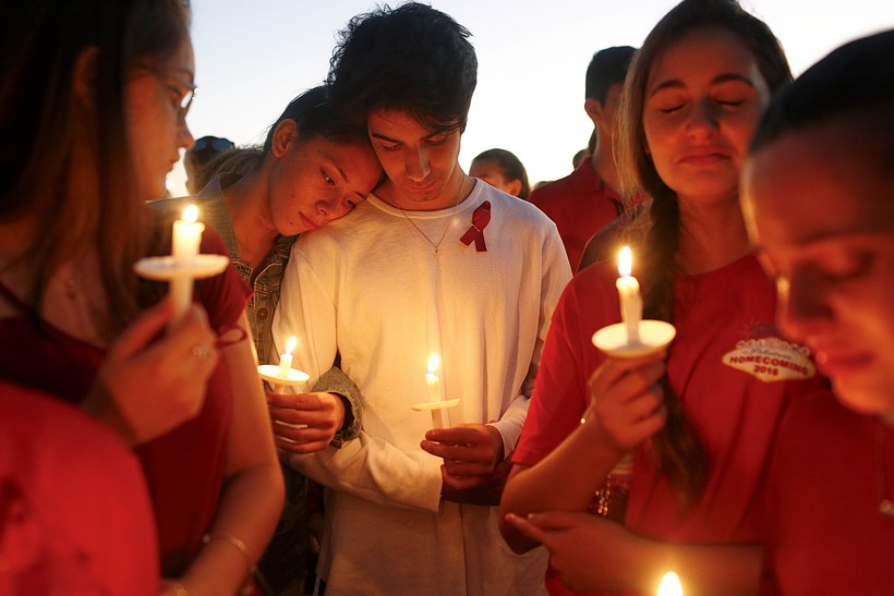 Students gather during a vigil for the victims of the Feb. 14 shooting in Parkland, Fla.