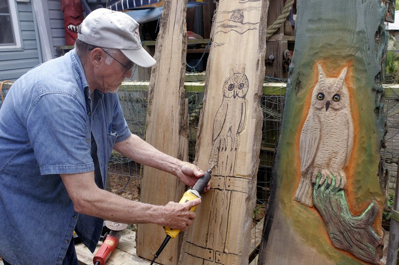 Florida man carves wooden owl panels