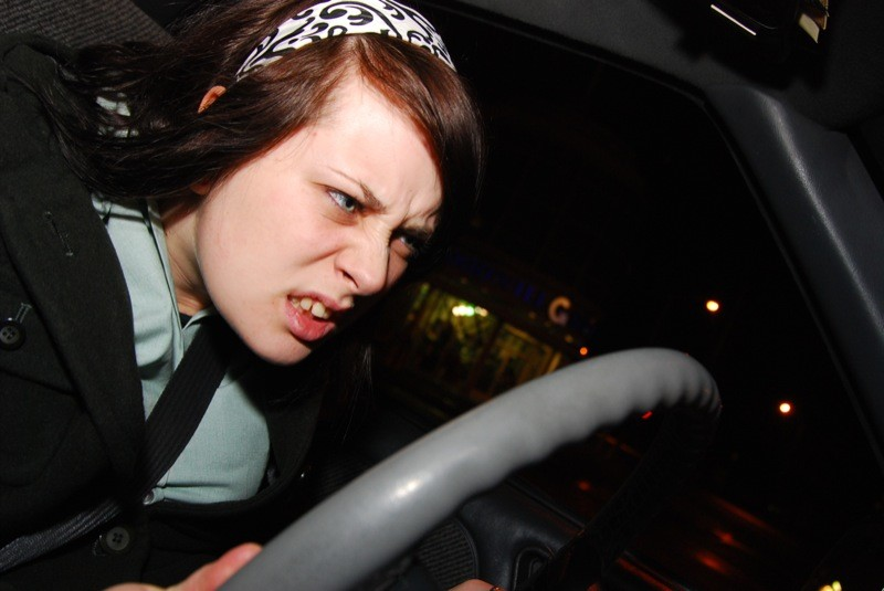 Angry girl at steering wheel
