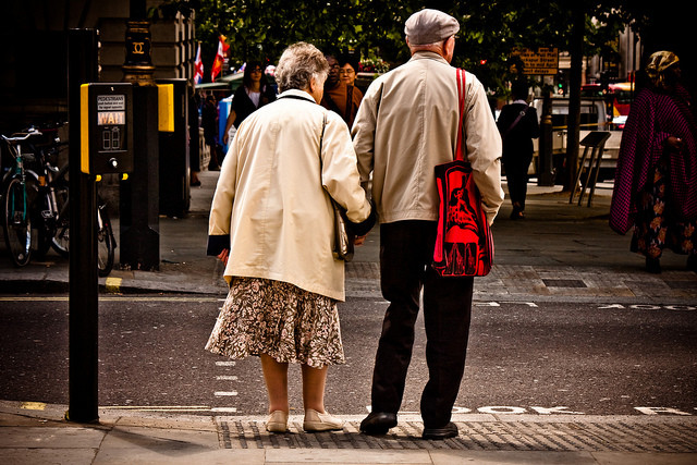 Aging Couple Crossing The Street