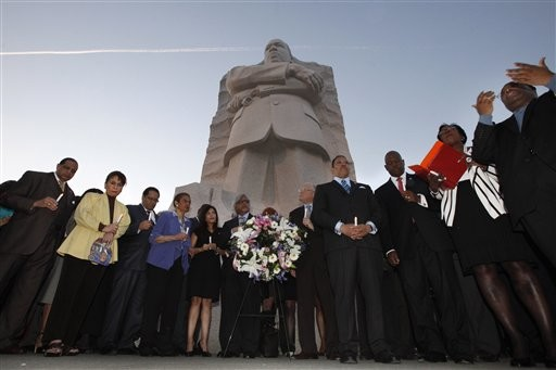 A gathering of officials and dignitaries hold electronic candles during a ceremony at the Martin Luther King, Jr. Memorial, on the 44th anniversary of the assassination of Dr. Martin Luther King, Jr. in Washington, on Wednesday, April 4, 2012.