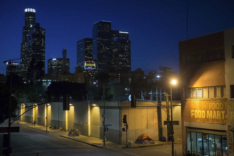 homeless people sleep in the Skid Row area in downtown Los Angeles