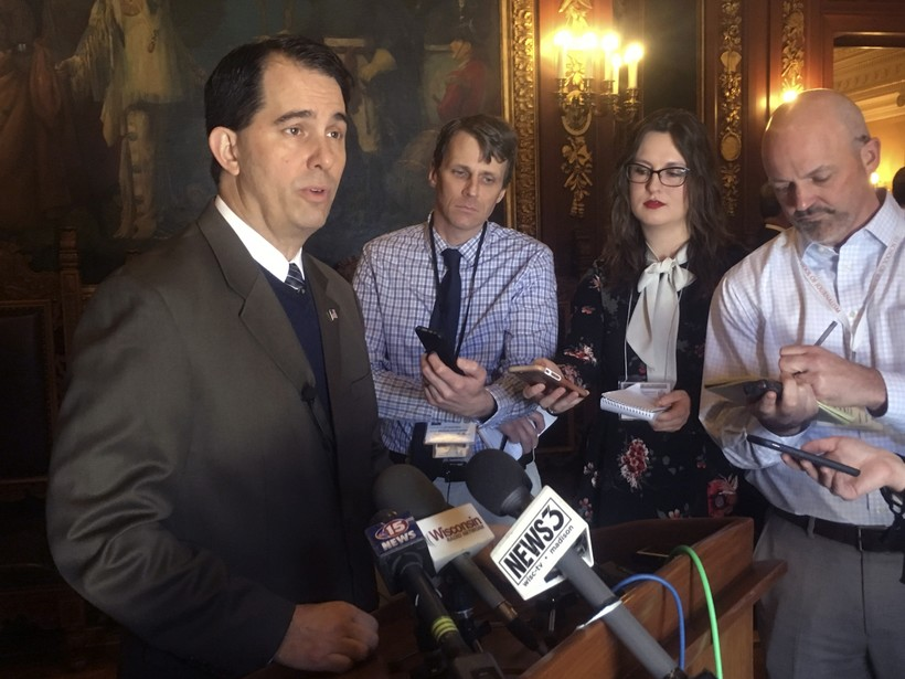 Wisconsin Gov. Scott Walker, speaks to reporters in Madison, Wisc.