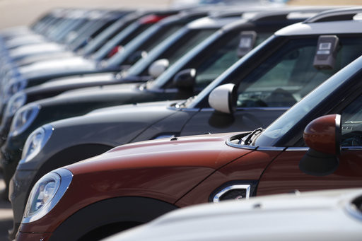 In this Monday, March 12, 2018, photograph, a long row of 2018 Countryman models is shown at a Mini Cooper dealership in Highlands Ranch, Colo.