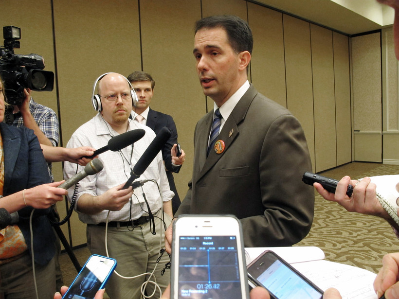 Gov. Walker talks to reporters in 2013