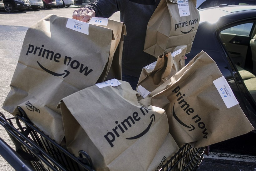Amazon Prime Now bags full of groceries are loaded for delivery