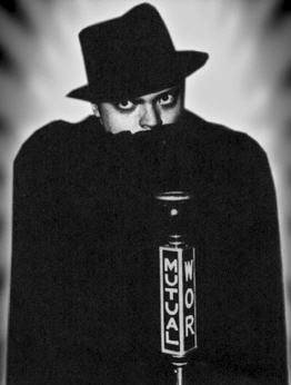 Photo of Orson Welles playing The Shadow
