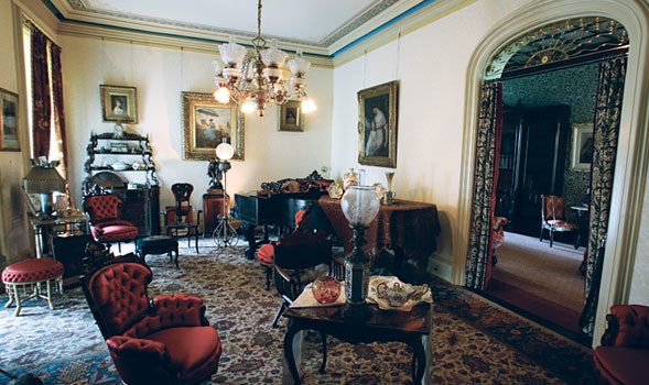 The elegant parlor features the mansion's best furnishings and artwork, as well as the rosewood Steinway.