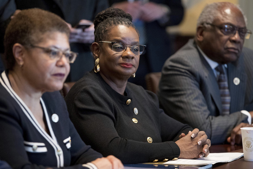 Rep. Gwen Moore, D-Wis., sits with other members of the Congressional Black Caucus