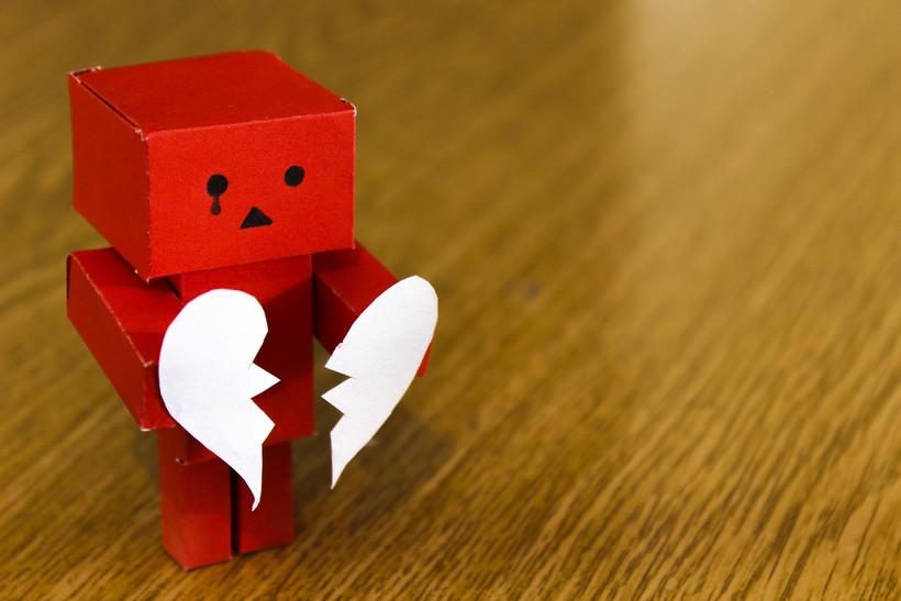 cardboard robot with a broken heart