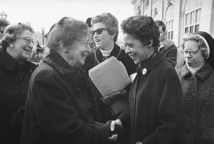 Jeanette Rankin, former Montana congresswoman and leader of a protest march in Washington, greets Milwaukee alderman Vel Phillips