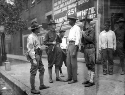 Soldiers stop black man in Washington D.C. in 1919