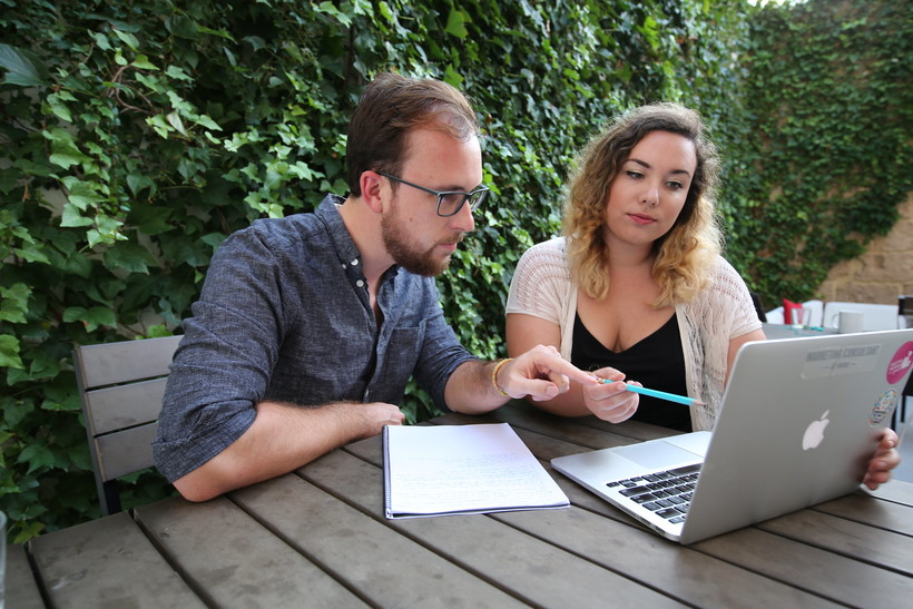 Woman and man using laptop computer