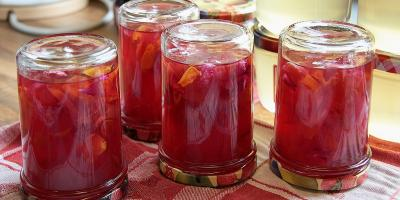 Cooling jars of rose jelly