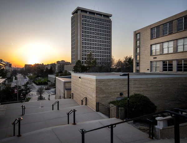 A sunset can be seen behind Van Hise Hall on UW-Madison's campus