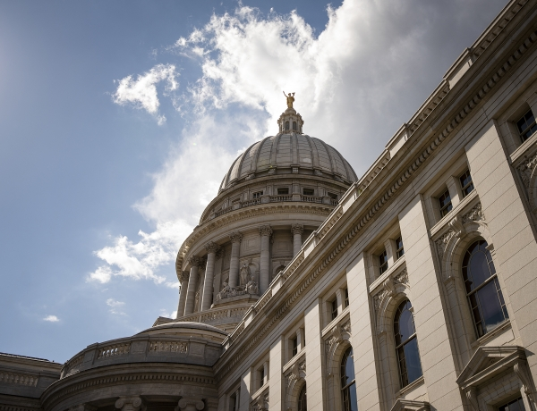 Clouds and a blue sky are the backdrop for the Wisconsin State Capitol