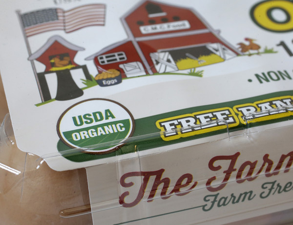 """""""USDA Organic"""" label is printed on the label of a carton of a dozen eggs"""