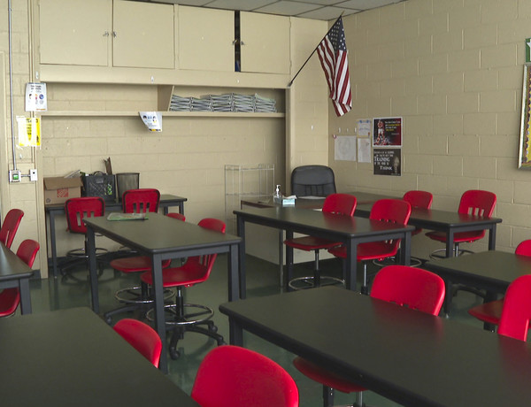 An empty classroom is shown at David Ellis Academy in Detroit