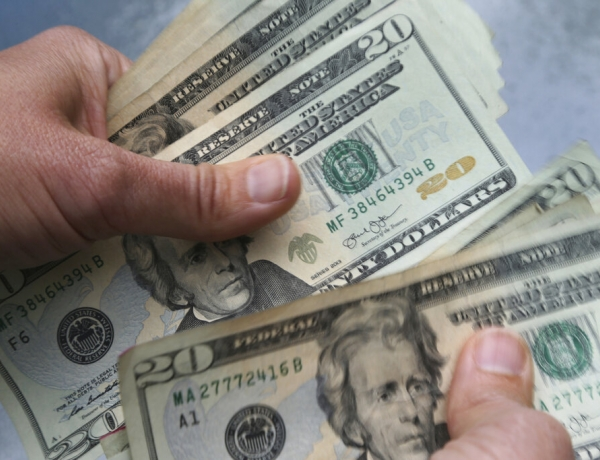 20-dollar bills being counted