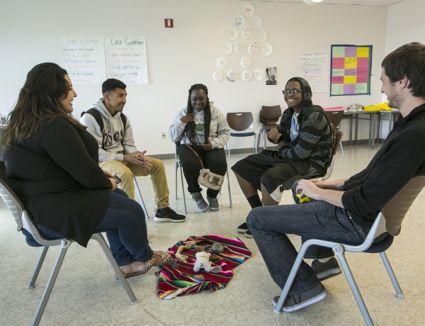 High school students attend a circle session at restorative justice class at the Augustus F. Hawkins High School in Los Angeles
