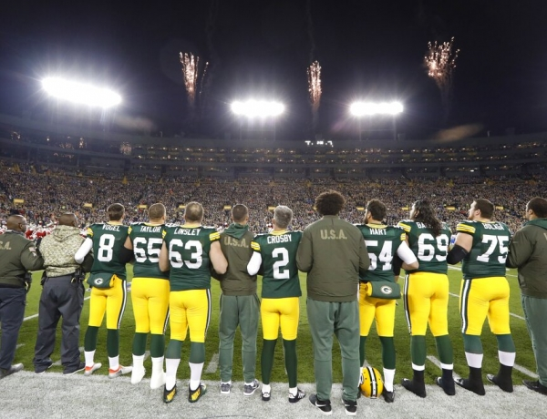 Players line up for the national anthem before a Green Bay Packers game at Lambeau Field