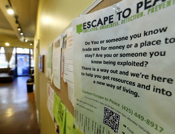 a poster on the wall advertising sex trafficking resources