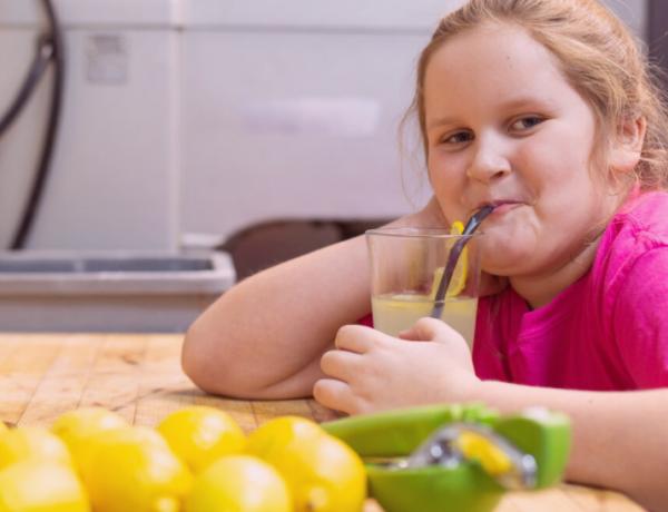 Morgan Marsh-McGlone sips a glass of lemonade