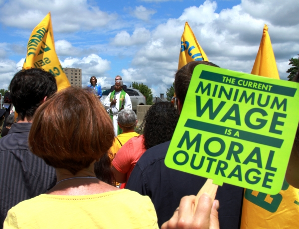 Worker holds up sign during minimum wage strike