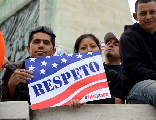 "Rallier holding a ""respeto"" sign"