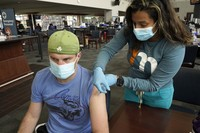 Kevin Fisher receives his second shot of Moderna COVID-19 vaccine