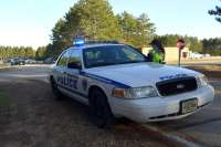 A Madison Police Department recruit gets into a squad car