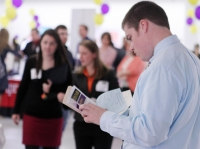 student looks over possible jobs at a jobs fair
