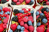 Containers of different types of berries.
