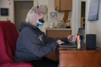 a woman uses a laptop computer